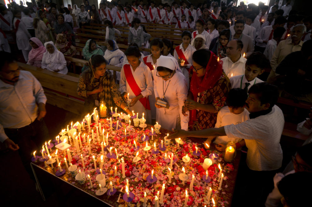 Pakistani Christians light candles during a vigil and special prayer service for the victims of the bomb explosions in churches and hotels in Sri Lanka, in Islamabad, Pakistan on Thursday. (B.K. Bangash/AP)