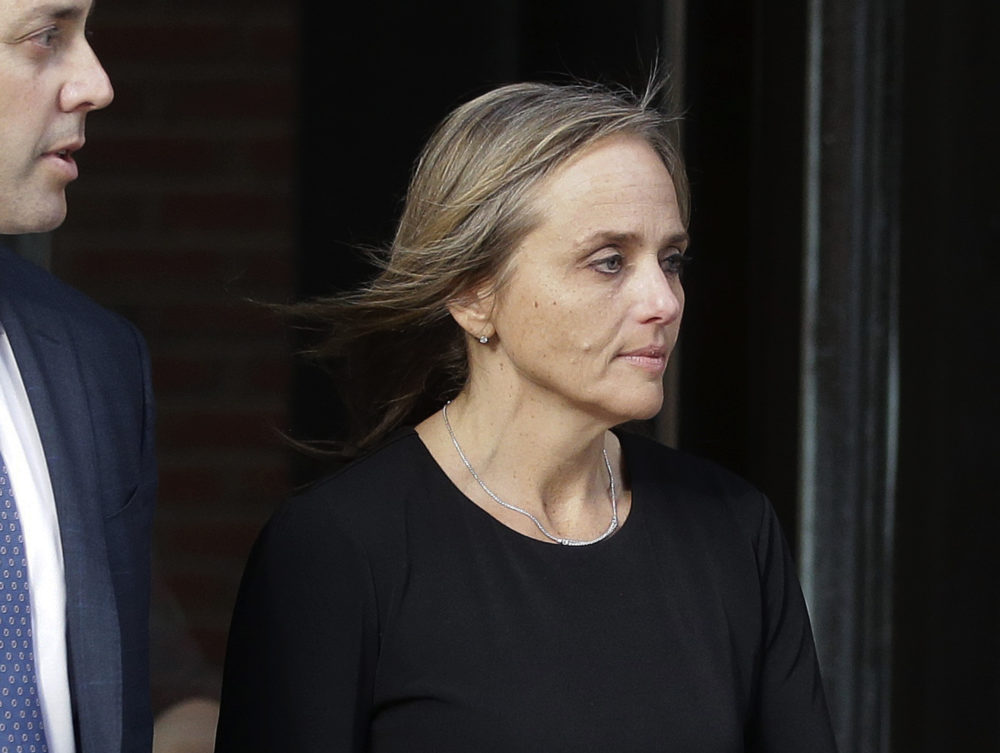 District Court Judge Shelley Richmond Joseph departs federal court in Boston after facing obstruction of justice charges for allegedly helping a man in the country illegally evade immigration officials as he left her Newton courthouse after a hearing in 2018. (Steven Senne/AP)