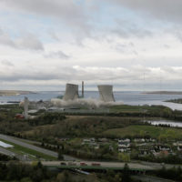 The two 500-foot cooling towers of the former Brayton Point Station in Somerset, Mass., are demolished with explosives. The plant had burned coal since 1963. (Benjamin Lescault/Grace Barker Health via AP)