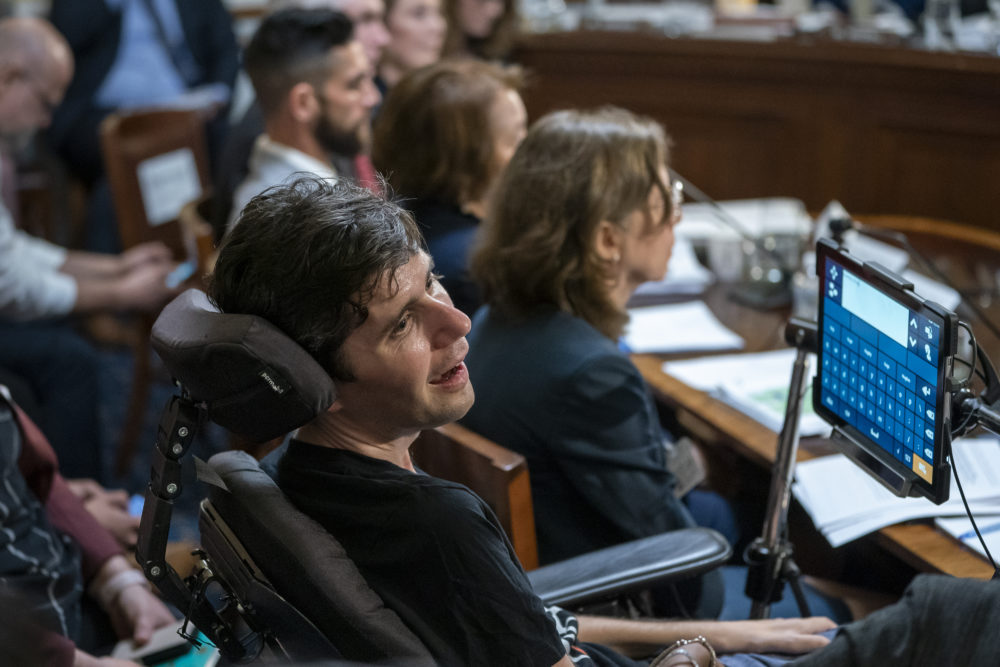 Ady Barkan, a health care activist who suffers from ALS, testifies before the House Rules Committee on Tuesday, April 30, 2019. (J. Scott Applewhite/AP)