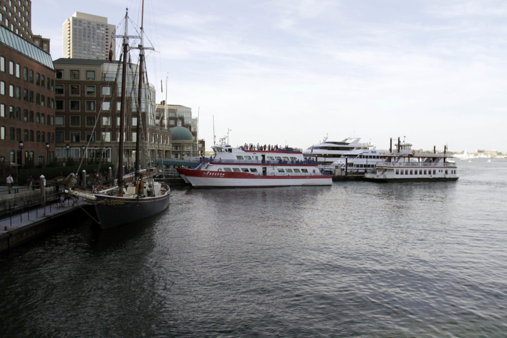 In this 2014 photo, commuter ferry boats sit docked at Rowes Wharf in Boston. (Bill Sikes/AP)