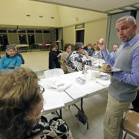 In this March 21, 2013 photograph, Rabbi Marshal Klaven leads a Seder, the traditional Passover meal, with members of St. Philip's Episcopal Church in Jackson, Miss. (Rogelio V. Solis/AP)