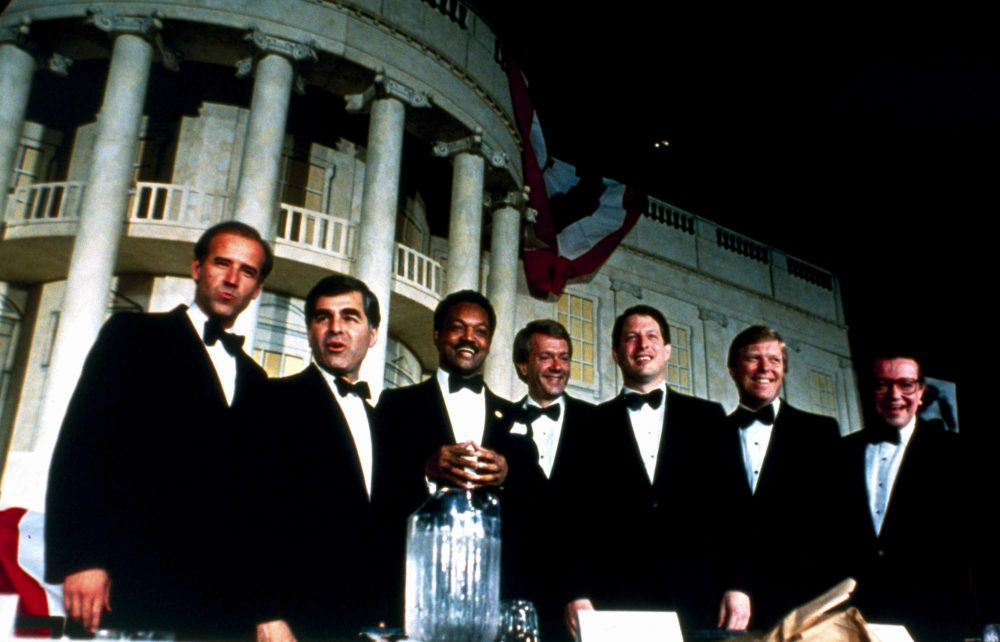 Democratic presidential candidates pose in front of a replica of the White House during an Independent Action Roast in Washington on June 23, 1987. Then-Sen. Joe Biden and Massachusetts Gov. Michael Dukakis are at left.  (Charles Tasnadi/AP)