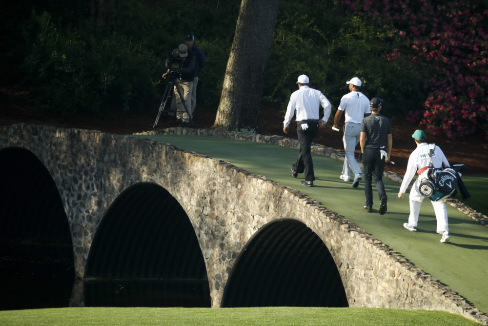 The Nelson Bridge takes golfers from Augusta's 13th tee towards the fairway. (Charlie Riedel/AP)
