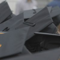 Graduates listen to speakers during University of Massachusetts -Boston commencement, Friday, May 29, 2009 in Boston. (Lisa Poole/AP)
