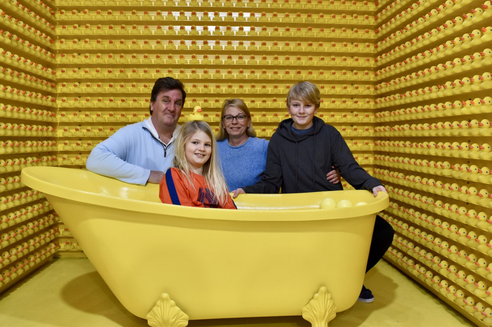 The O'Connor family poses in the bathtub room. From left, Bill, Anne, Kelly and Bill. (Meghan B. Kelly/WBUR)