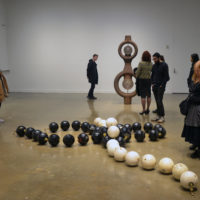 A group of visitors look at Kathleen Ryan's sculptures at the MIT List Visual Arts Center (Courtesy)