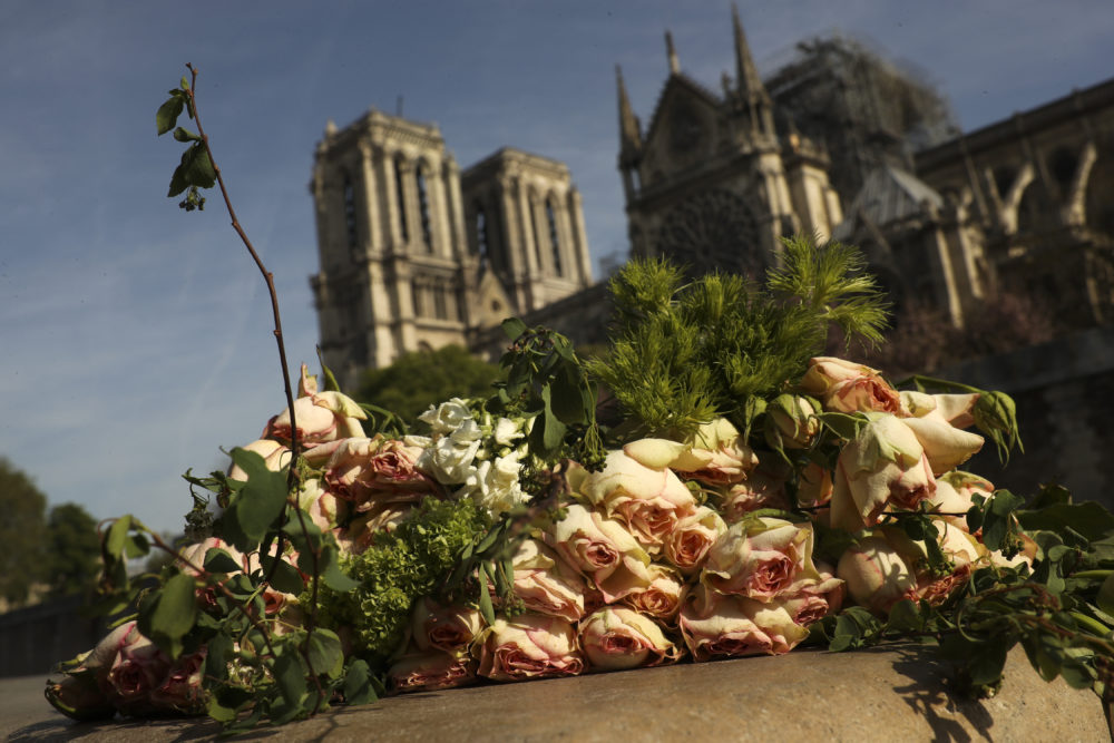 A bunch of flowers lies by the Seine riverside near the Notre Dame cathedral in Paris, Thursday, April 18, 2019. (Francisco Seco/AP)
