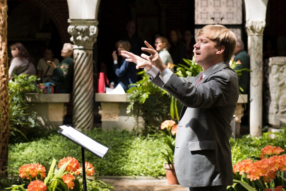 George Steel conducting in the Isabella Stewart Gardner Museum courtyard. (Courtesy Liza Voll)