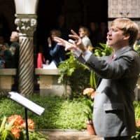 George Steel conducting in the Isabella Stewart Gardner Museum courtyard. (Courtesy Liza Voll)