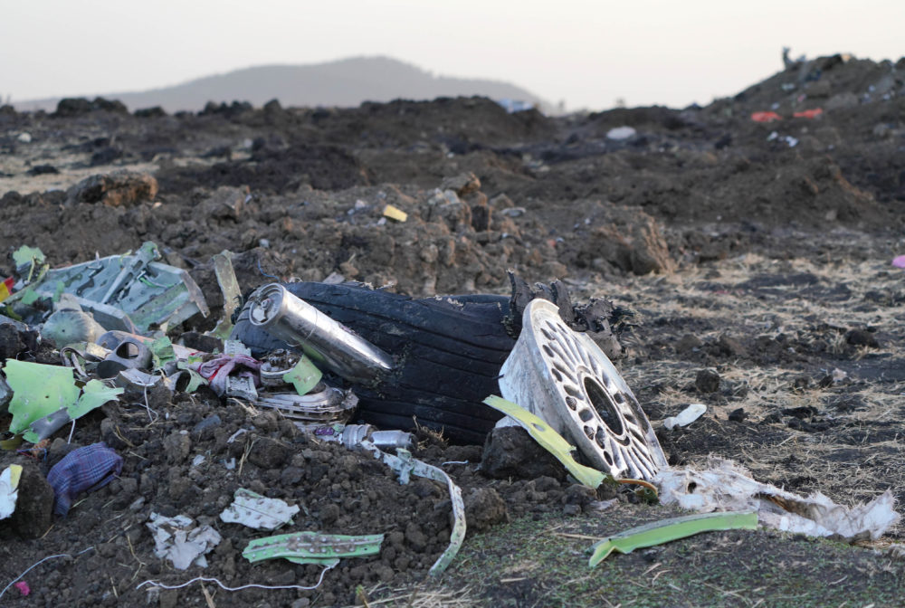 Parts of an engine and the landing gear lay in a pile after being gathered by workers during the continuing recovery efforts at the crash site of Ethiopian Airlines flight ET302 on March 11, 2019 in Bishoftu, Ethiopia.(Photo by Jemal Countess/Getty Images)
