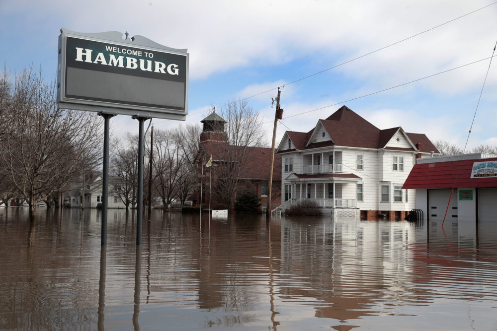 A home sits in flood water in Hamburg, Iowa. Although flood water in the town has started to recede many homes and businesses remain surrounded by water. (Scott Olson/Getty Images)