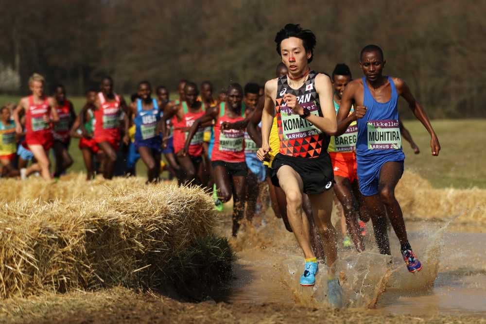 Yohei Komatsu of Japan and Felicien Muhitira of Rwanda compete in the Senior Men's final during the IAAF World Athletics Cross Country Championships on March 30, 2019 in Aarhus, Denmark. (Bryn Lennon/Getty Images)
