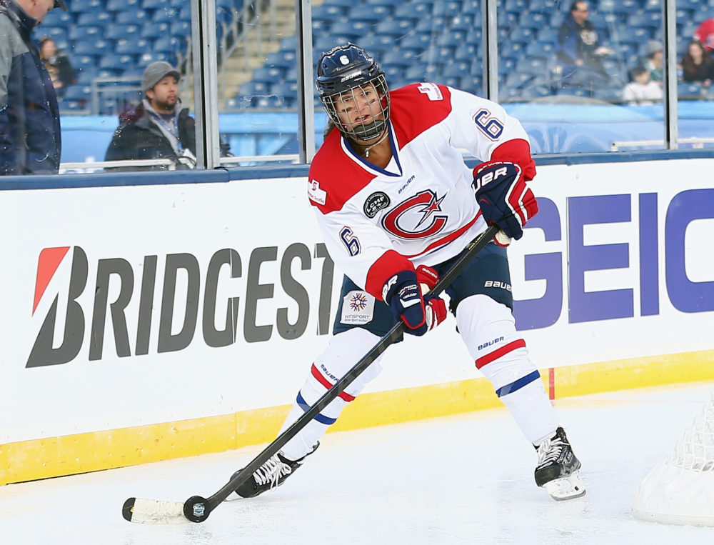 In this Dec. 31, 2015 photo, Carly Hill, then of the CWHL's Les Canadiennes, skates against the Boston Pride of the NWHL. (Maddie Meyer/Getty Images)