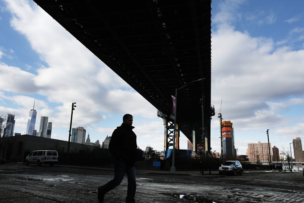 A man walks under the Manhattan Bridge on February 16, 2017 in New York City. (Spencer Platt/Getty Images)