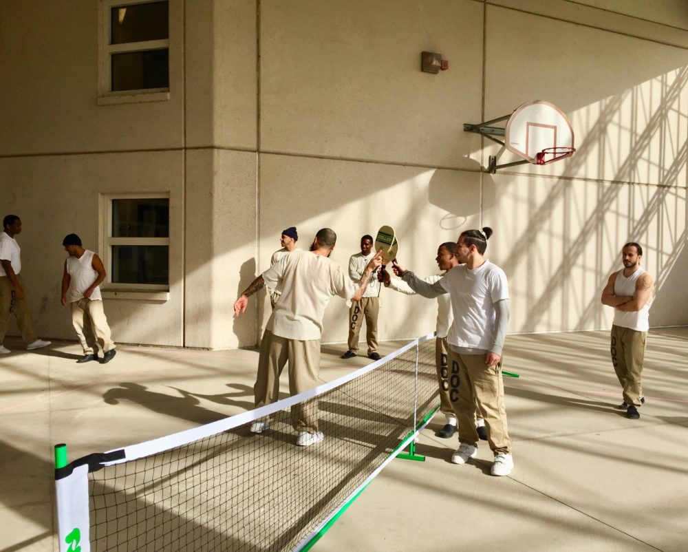 Detainees get ready for a pickleball match (Courtesy of Roger Bel Air)