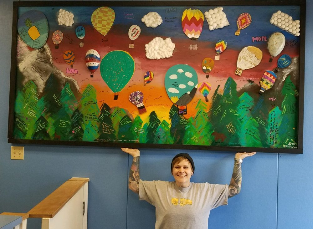 Artist Jessie Mercer shines some color at Pine Ridge School. (Courtesy of Jessie Mercer)