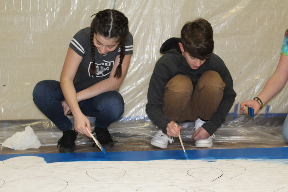 Students at Pine Ridge forget the Camp Fire and put their paint brushes to work. (Ashley Bailey/Here & Now)