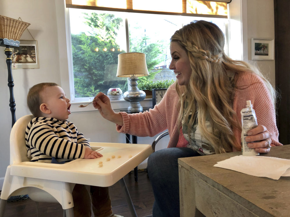 Jocelyn Smith cares for her 11-month-old son, Mason at their home in Camas, Wash., on Jan. 30, 2019. Smith has been afraid to take Mason out of the house during a measles outbreak in southwest Washington because he is too young to receive the measles vaccine. (Gillian Flaccus/AP)