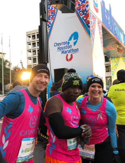 Nick Silver, center, and his guides Ben Stahl and Cheyenne Meyer at the 2019 Houston Half Marathon. (Courtesy Cheyenne Meyer)