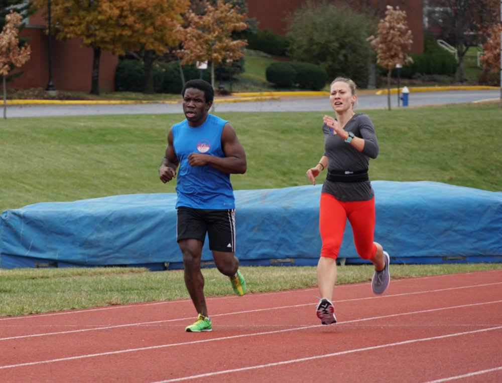 Nick Silver (left) runs alongside guide Liz Houghton. (Shahla Farzan for WBUR)
