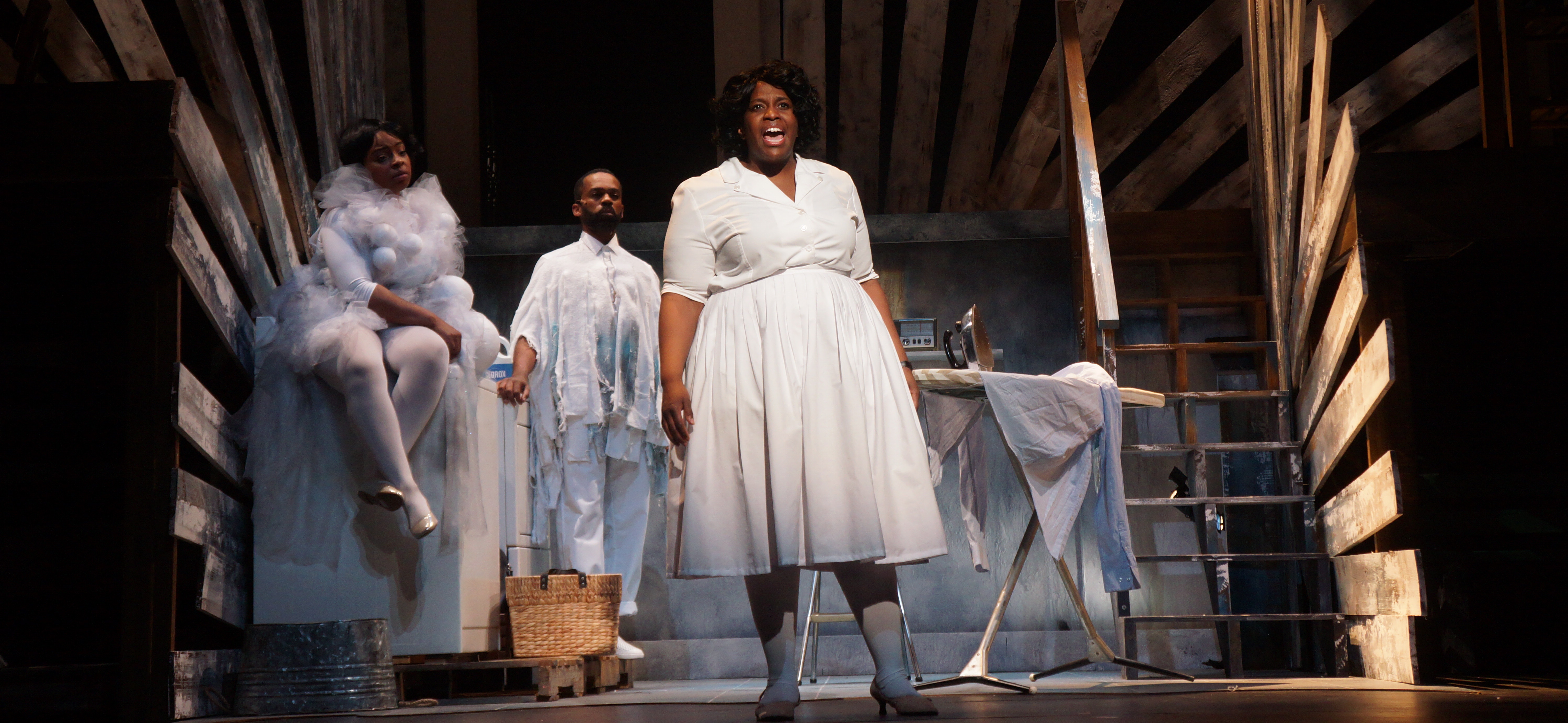 "Yewande Odetoyinbo (right) as Caroline in Moonbox Productions' ""Caroline, or Change"" at the Calderwood Pavilion. Pier Lamia Porter and Davron S. Monroe give life to the washer and dryer. (Courtesy Sharman Altshuler)"