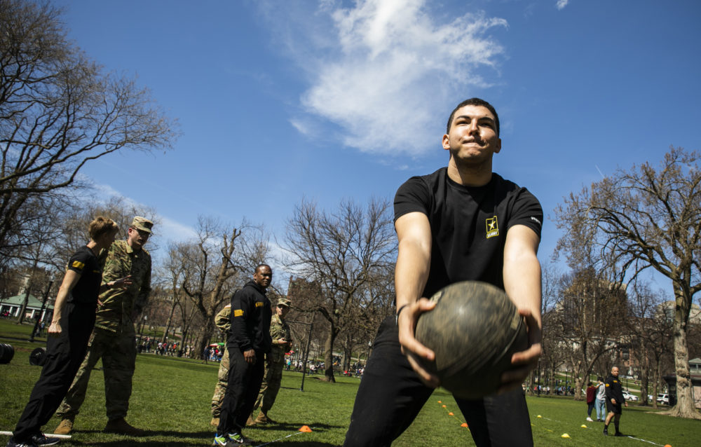 Paulo Deoliveira throws a 10-pound ball during a practice fitness training at the first-ever Army Week hosted by the U.S. Army at Boston Common, on April 13. (Erin Clark for WBUR)
