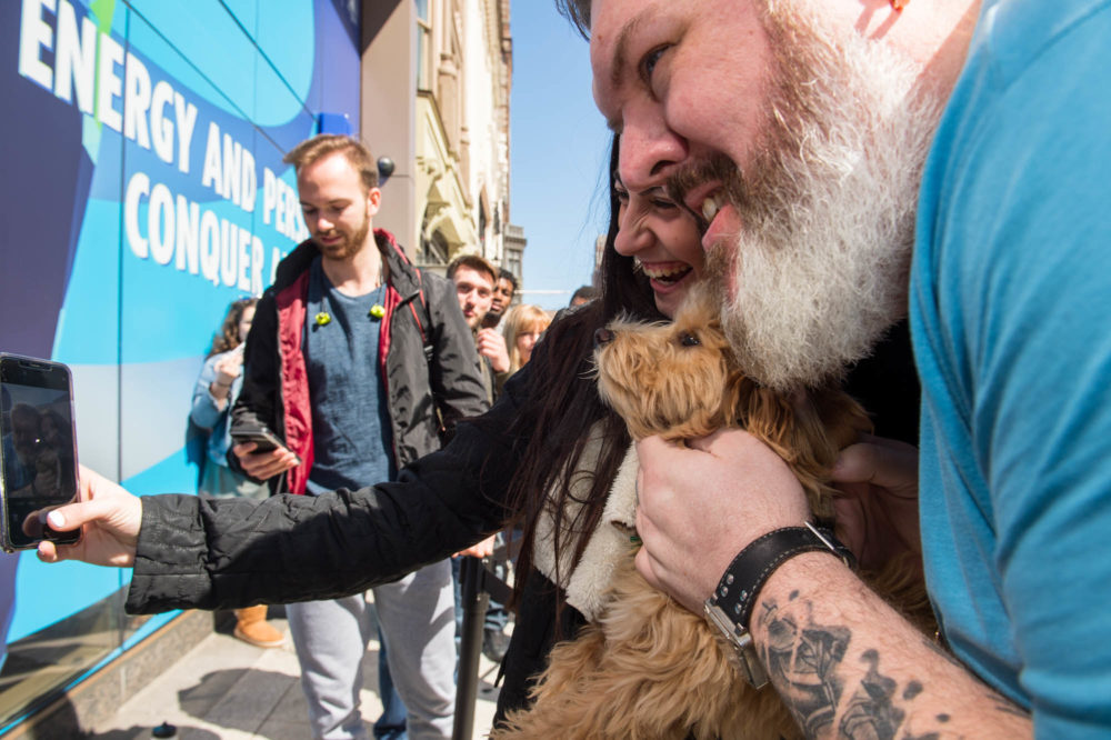 "Kristian Nairn, who plays Hodor in ""Game of Thrones,"" poses with fans in Boston. (Courtesy Casey Photography)"