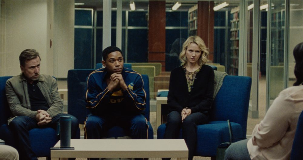 """Luce (Kelvin Harrison, Jr.) sits with his adoptive parents, Amy and Peter Edgar (Naomi Watts and Tim Roth) in """"Luce."""" (Courtesy IFFB)"""