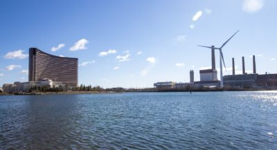 The Encore Boston Harbor Casino in Everett is seen from across the Mystic River in Somerville. (Jesse Costa/WBUR)