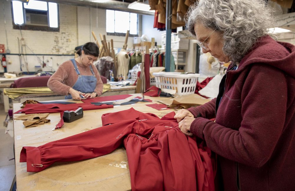 """Therese Beck and Lila West work on costumes for the Boston Lyric Opera's production of """"The Handmaid's Tale."""" (Robin Lubbock/WBUR)"""