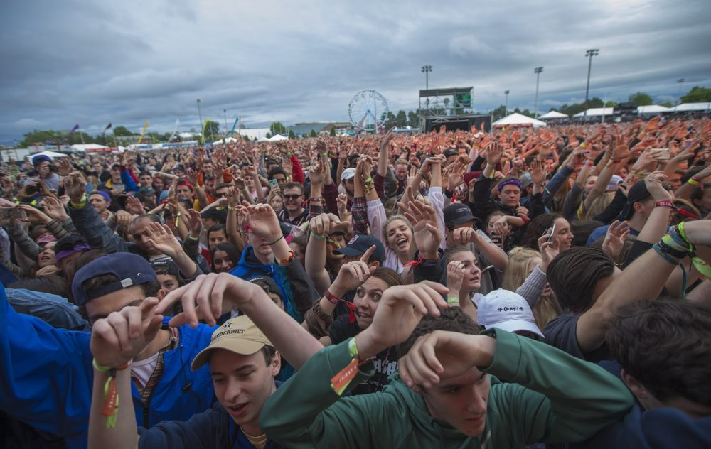 The crowd at Boston Calling all with their hands in the air. (Jesse Costa/WBUR)