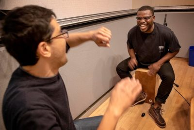 Jonathan Mande plays cajon with Jorge Perez-Albela at WBUR's studios. (Robin Lubbock/WBUR)