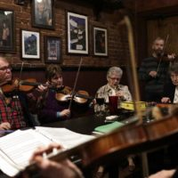 Musicians join into the Irish session at the Green Briar in Brighton on a Monday night. (Hadley Green for WBUR)