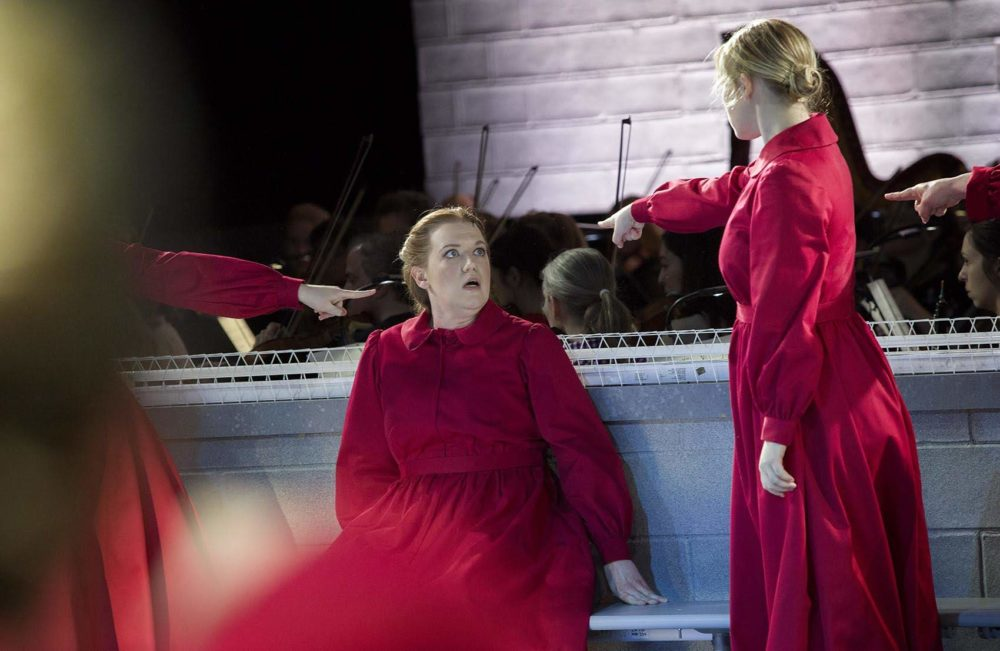"""Jennifer Johnson Cano plays Offred, at a rehearsal of """"The Handmaid's Tale."""" (Robin Lubbock/WBUR)"""