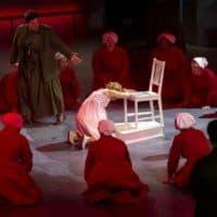 "Handmaids gather round a pregnant handmaid, at a rehearsal of ""The Handmaid's Tale."" (Robin Lubbock/WBUR)"