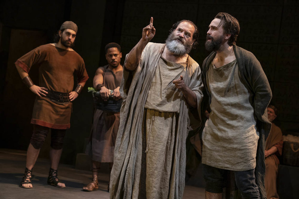 """Alan Mendez, Ro Boddie, Michael Stuhlbarg and Joe Tapper onstage in the Public Theater production of """"Socrates."""" (Joan Marcus/Courtesy of the production)"""
