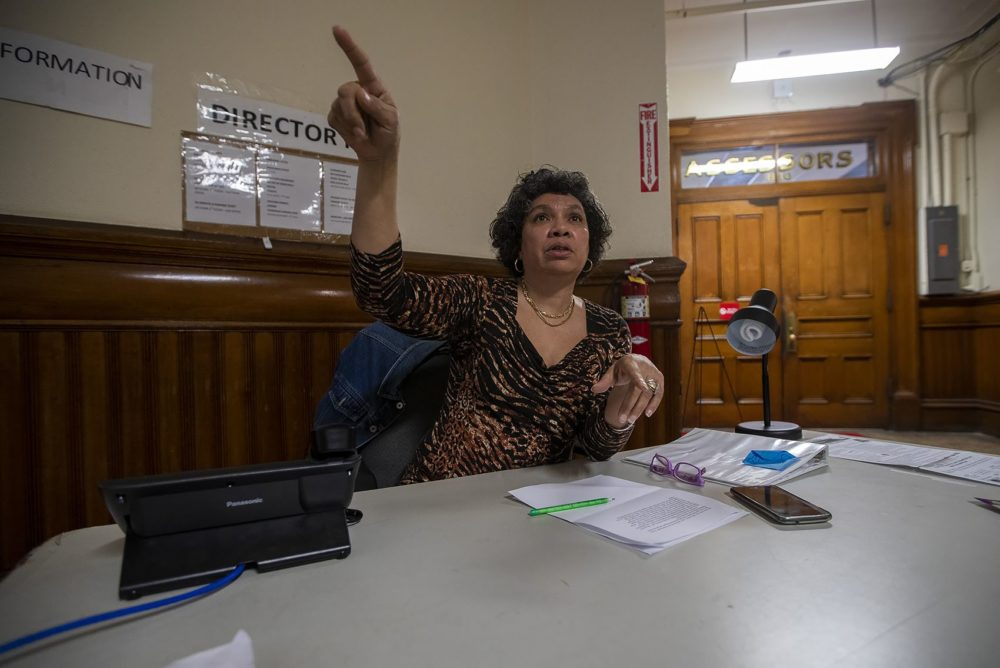 Joi Simmons directs a patron to where he needs to go in Brockton City Hall. (Jesse Costa/WBUR)