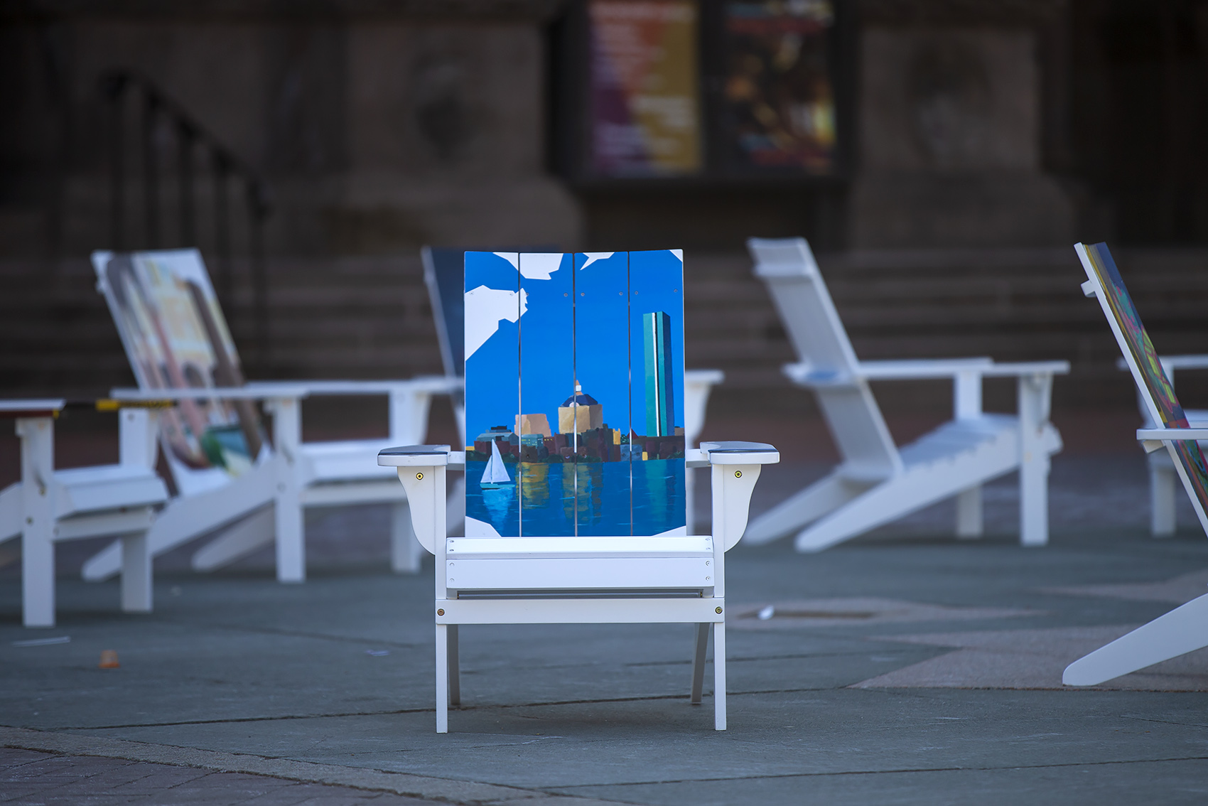 One of the chairs, painted with the Charles River and the Boston skyline. (Jesse Costa/WBUR)