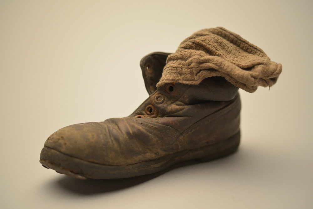 This child's shoe and sock were found in January 1945 among thousands of others at Auschwitz-Birkenau — abandoned by the Nazis as the Red Army approached. (Courtesy of the Collection of the Auschwitz-Birkenau State Museum, Oświęcim, Poland)