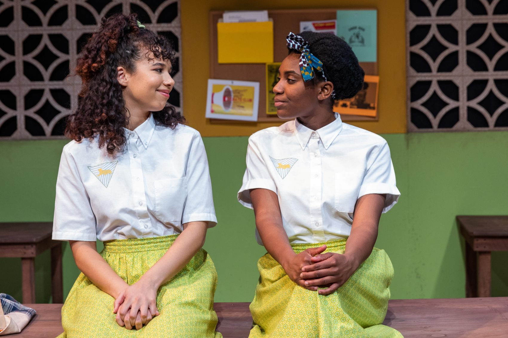 "Victoria Byrd as Ericka and Ireon Roach as Paulina in SpeakEasy Stage's ""School Girls."" (Courtesy Maggie Hall Photography)"
