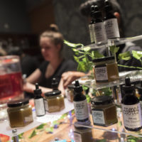 Samples of THC laced products are on display as a bartender prepares drinks at the Spleef NYC canna-cocktail party in New York. (Mary Altaffer/AP)