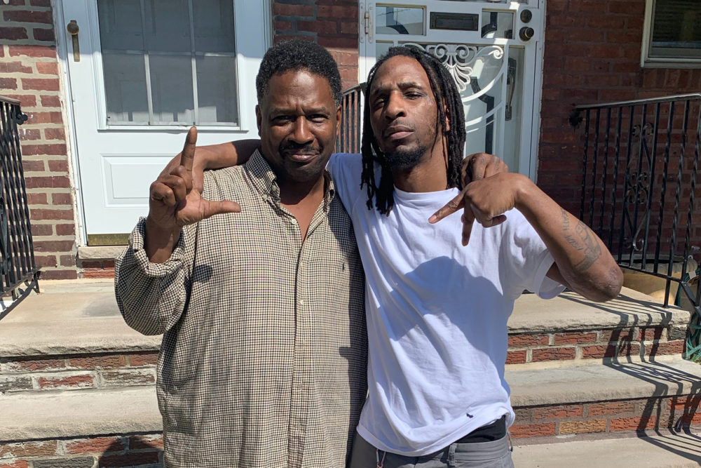 "Hassan Bennett (right) stands with his father after being acquitted of second-degree murder. The ""LA"" sign they are holding up represents Lansdowne Avenue, the Philadelphia neighborhood where they were both raised. (Courtesy of Hassan Bennett)"
