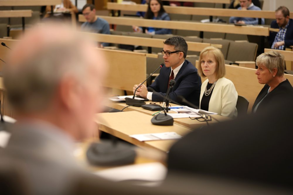 A panel from the Massachusetts Gaming Commission -- Associate Counsel Justin Stempeck, Commissioner Cathy Judd-Stein and Commissioner Gayle Cameron -- testified before lawmakers Tuesday, leading off a hearing on sports betting proposals in the Bay State. (Sam Doran/SHNS)