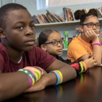 From left: Seventh graders DJ Mitchell, Trinity Raye and Ariani (who preferred not to give her last name) at the Helen Y. Davis Leadership Academy Charter Public School in Dorchester (Robin Lubbock/WBUR)