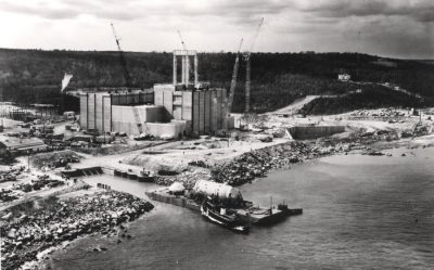 In this photo, circa 1971, the 525-ton, 65-foot-tall reactor vessel arrives by boat at the Pilgrim Nuclear Power Station. (Courtesy U.S. Department of Energy)