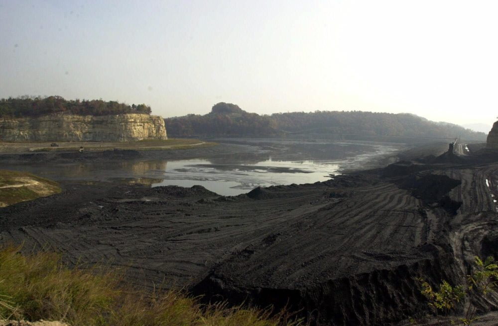 This 2000 file photo shows the remains of a Martin County Coal sediment pond that collapsed near Inez, Ky. The release turned sections of the Tug Fork and the Big Sandy rivers black and forced officials to seek alternative sources of water for thousands of residents. Drinking water problems continue today as the water district struggles to update aging infrastructure. (Bob Bird/AP)