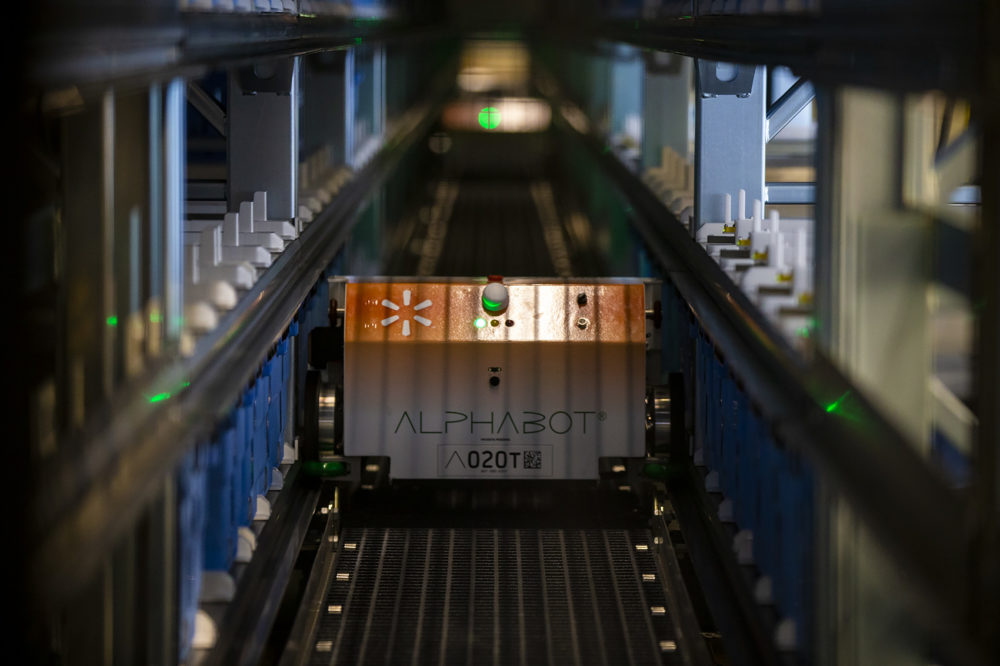 Walmart's Alphabot retrieves grocery items from a 20,000-square-foot warehouse, which it moves from storage to associates who fill online purchases at the Walmart Supercenter in Salem, New Hampshire. (Jesse Costa/WBUR)