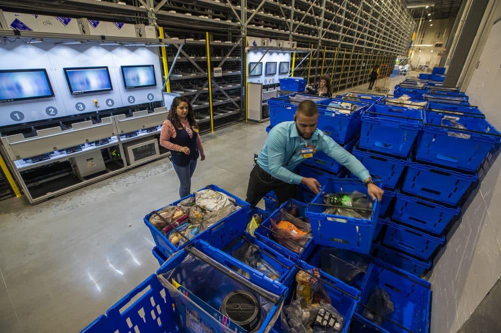 Walmart associates setting up orders for grocery pickup. (Jesse Costa/WBUR)
