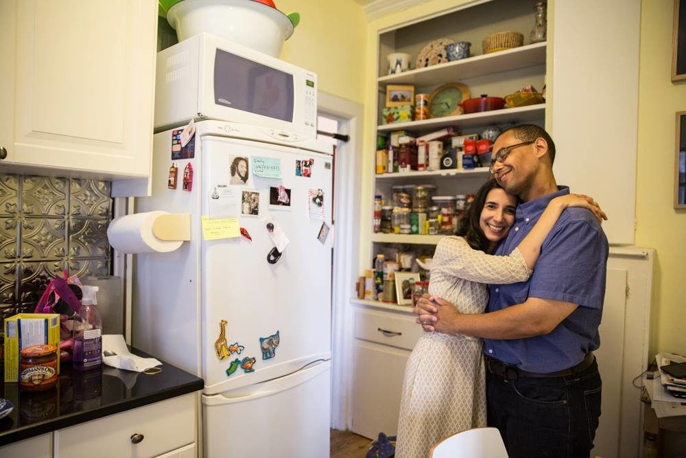 Emily Raboteau and her husband, Victor LaValle, in their New York City apartment in August, 2013. (Credit Eneida Cardona)